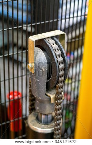 Detail Close Up Image Of Forklift Portable Pallet Lifter Chain Assembly.