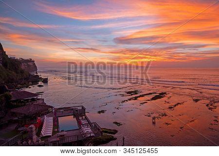 Aerial from a beautiful sunset at Uluwatu area on Bali Indonesia