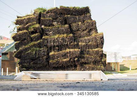 Stack Of Grass Sod Residential Development