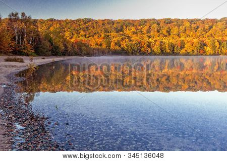 Autumn Lake Reflections. Vibrant Fall Colors Reflected In The Northern Michigan Monocle Lake At The