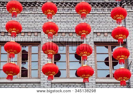 Group of red lanterns hanging on the black brick wall in the Chinese new year, Fuzhou,China.  The black bricks is the style of typical architecture of southern China in the Late Qing Dynasty.