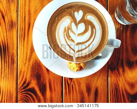 Cup Of Cappuccino Standing On A Wooden Table, White Cup On A Plate With Cookies, Texture Of Old Wood