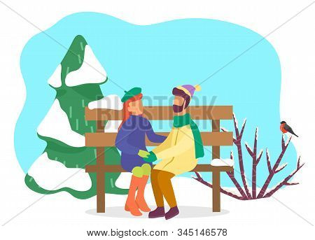 Couple On Date In Winter Park. Man And Woman Wearing Warm Clothes Hugging Sitting On Wooden Bench Co