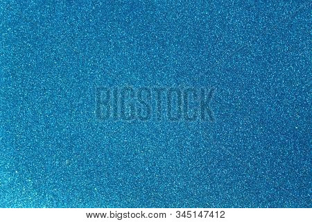 The Picture Shows Background With Blue Glittery Paper