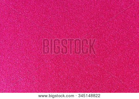 The Picture Shows A Pink Glittery Background