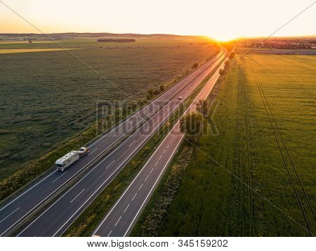 Cars on the road at sunset. Car. Travel. Road trip. Car rental.
