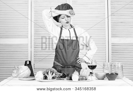 Housewife Cooking And Drink Wine. Enjoy Easy Ideas For Dinner. Woman Enjoy Cooking Food. Housekeepin