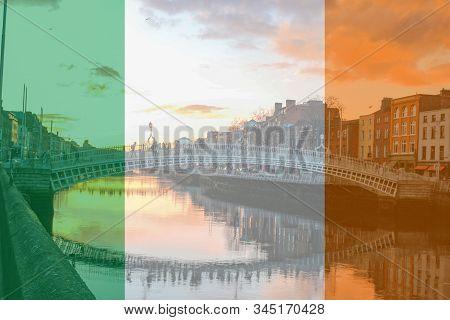The Flag Of Ireland As A Composite Over Hapenny Bridge In Dublin