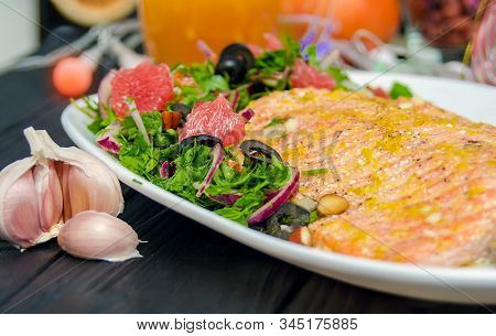 Oven Baked Salmon With Grapefruit Salad. Red Salmon Fish Steak Served With Salad And Olive Oil On Pl
