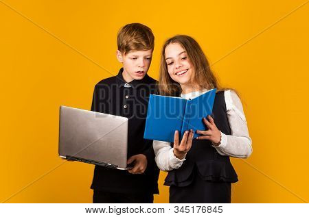 Opportunities For Studying. Little Children Enjoy Studying Together Yellow Background. Small Girl An