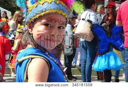 Cuenca, Ecuador - February 27, 2019: Carnival Parade For Children In Cuenca. Little Girl In Traditio