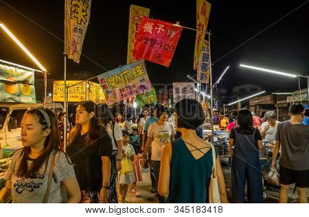 Puli, Taiwan - October 10th, 2019: famous holiday night marketplace with people walk and shop at Puli town, Nantou, Taiwan