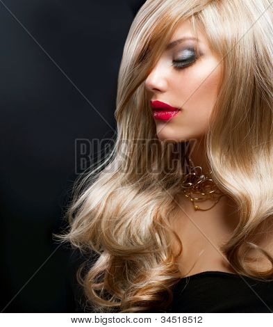 Blond Hair. Beautiful Blond Woman over Black