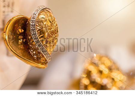 Golden Jewelry In A Shape Of Heart At Traditional Emirati Market