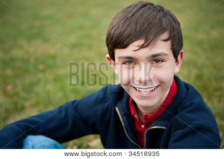 Smiling Teenage Boy Outside