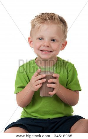 Young Boy Holding Chocolate Milk On White