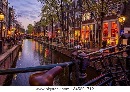 Amsterdam, Netherlands. June 10, 2019. Amsterdam City Skyline Sunset Timelapse At Canal Waterfront,