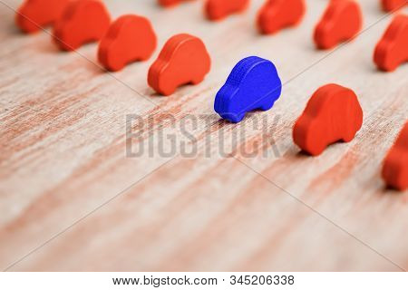 Tendering Or Competition For The Contract. Red Toy Cars On Wooden Background. Equal Conditions. Leve
