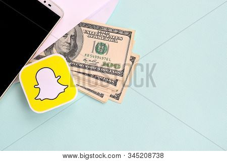Snapchat Paper Logo Lies With Envelope Full Of Dollar Bills And Smartphone