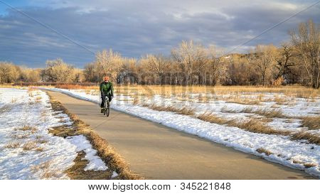 male cyclist on a bike trail - Poudre River Trail in northern Colorado, biking, recreation and commuting concept