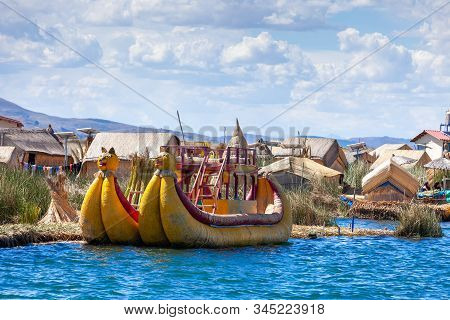 Traditional Reed Boat As Transportation For Tourists, Floating Uros Islands On Lake Titicaca In Peru