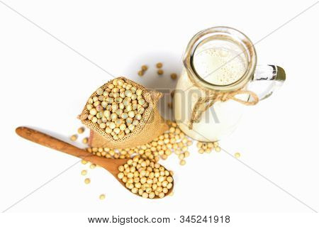 Soy Milk In Glass Jar For Healthy Diet And Natural Bean Protein / Soybean On Wooden Spoon And Dried