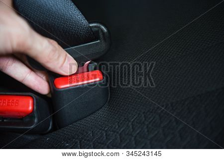 Car Seat Belt While Sitting Inside The Car Before Driving And Take A Safe Journey / Hand Fastens The
