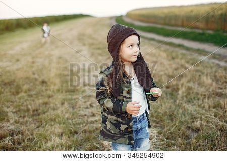 Cute Little Child In A Summer Field With A Kite