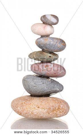 Stack of balanced stones isolated on white