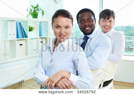 Portrait of successful business team with pretty leader in front