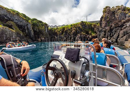 Santa Cruz Das Flores, Portugal - August 9: Unidentified Tourists Wait On Boats Before Traveling To