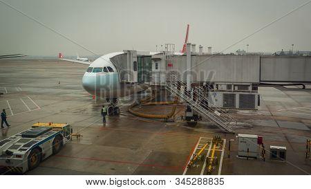 Shanghai, China - January 28, 2019: Airplane Ready For Boarding In Shanghai Airport Hub On Rainy Day