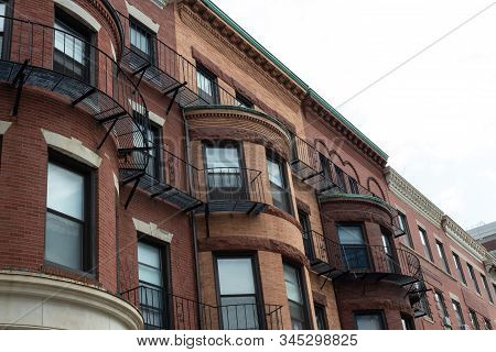 Beautiful Brick Brownstones Displaying A Variety Of Beautiful And Ornate Architectural Details. Hori