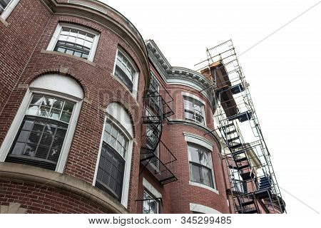 Scaffolding Affixed To Face Of A Brownstone Apartment Building, View Looking Up, Horizontal Aspect
