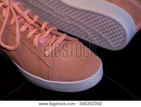 On Black Background Pale Pink Womens Sports Sneakers With White Sole. Street Style And Fashion. Adve