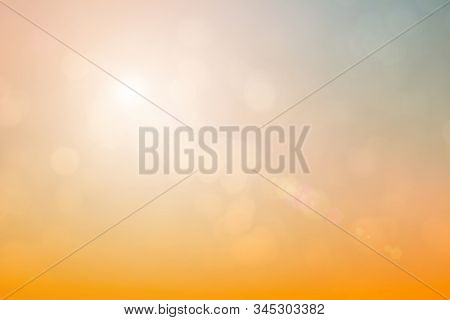 Natural Background Blurring Warm Colors And Bright Sun Light. Bokeh Or Christmas Background Green En