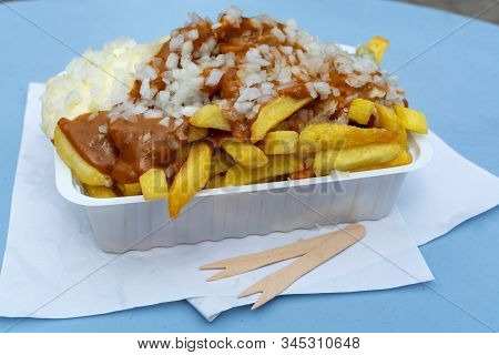 Traditional Dutch Fast Food Dish, Fried Potatoes With Sate Sauce, Onion And Mayonaise, Fat And Not H