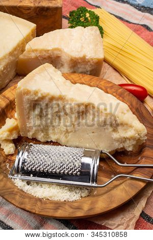 Cooking With Hard Italian Cheese, Grated Parmesan Or Grana Padano Cheese