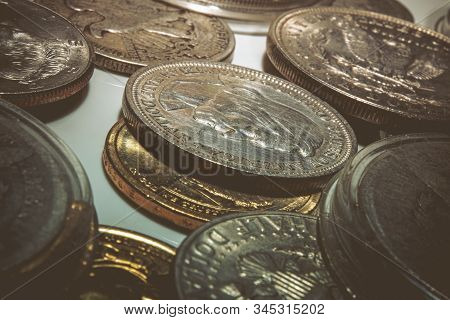 Various Collectible Coins On A Table. Macro Photo. United States Monetary.