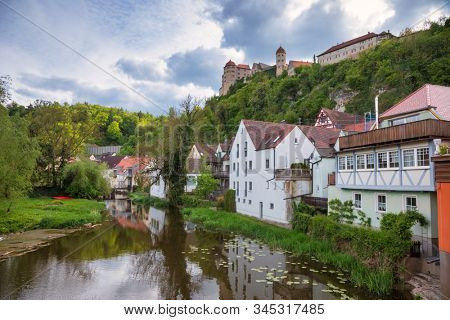 Gabled houses along the Wornitz river with Harburg Castle in background, Harburg, Swabia, Bavaria, Germany. Harburg is a popular destination on Romantic Road touristic route
