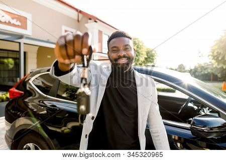 Portrait Of African Man Car Seller Holding Car Keys. Attractive Cheerful Young African Man Smiling S