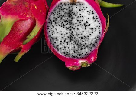 Dragon Fruit. Vibrant Dragon Fruit On Black Background. Sliced White Dragon Fruit Or Pitaya On Black