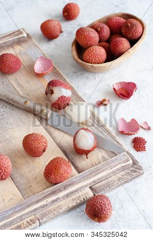 Fresh Litchi Fruits With A Knife On A White Table Close Up