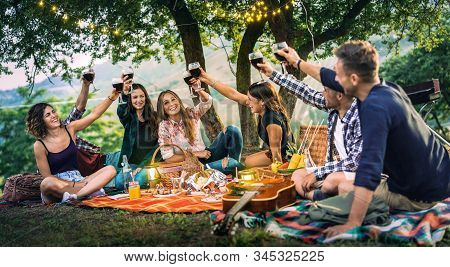 Happy Friends Having Fun At Vineyard On Sunset - Young People Millenial Toasting At Open Air Picnic