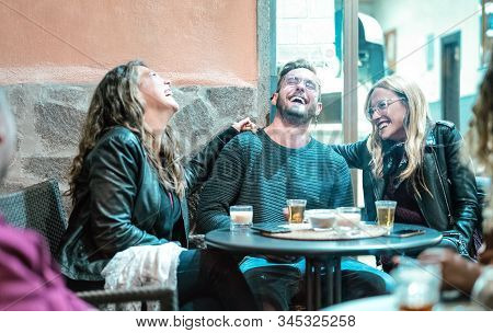 Young Friends Having Genuine Fun Drinking On Happy Hour At Street Bar - Millenial People Laughing An