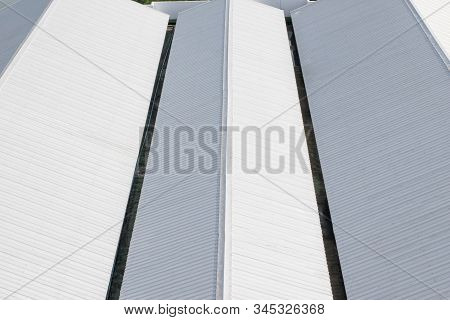 Warehouse Roof,metal Sheet Roofing On Commercial Construction.