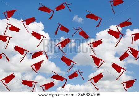 Airborne Red Graduation Hats With Tassels In Summer Blue Sky