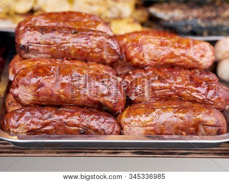 Heap Of Freshly Grilled Chicken Or Pork Meat Sausages At Street Food Festival, Selective Focus, Clos