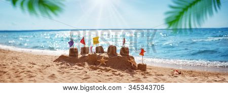 Sandcastle On The Blue Sea In Summertime