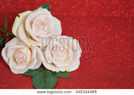 Valentines Day Card With Three Beige Roses On Red Boke Background. Copyspace - Love And Wedding Day